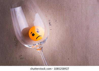 sad alcoholic trapped in a glass