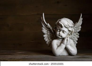 Sad angel: idea for a greeting or condolence card.