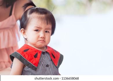 Sad asian baby girl crying and upset