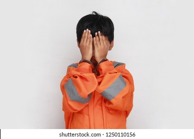 sad asian boy using handcuff. child arrested.