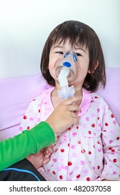 Sad asian child was bronchitis and crying. Kindly brother take care his sister with asthma problems making inhalation by mask at hospital. Happy family concept, loving and bonding of sibling.