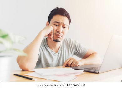 Sad Asian man has problems with billing and debts.