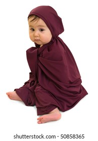 Sad baby girl sitting in purple muslim dress