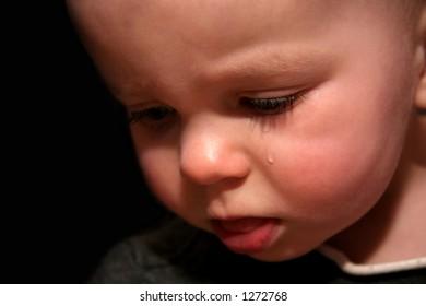 Sad baby with tear