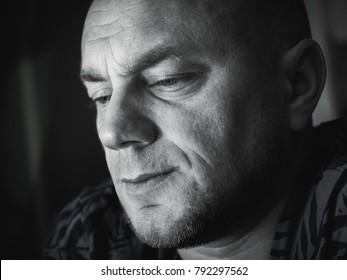 Sad bald man. Black and white close-up portrait