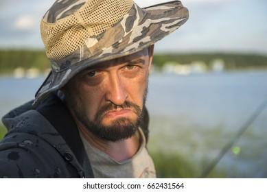 sad bearded man on a fishing