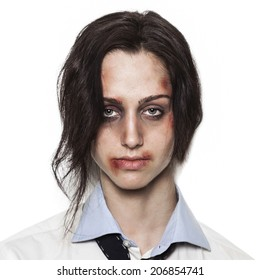 Sad beaten up girl with wounds on the face looking at the camera with deep look