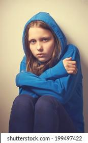 Sad,  beggar teen girl
