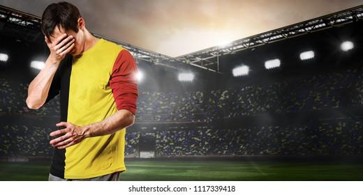 Sad Belgium national team soccer or football player on stadium
