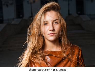 Sad or blank expression young 20s woman at night