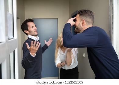 Sad Blonde Young Woman Looking At Neighbor Man Quarreling