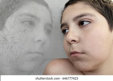Sad boy crying. Violence in the family and school.