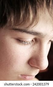 sad boy face close up