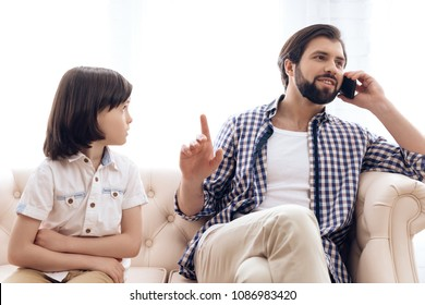 Sad boy got upset because of lack of attention from father. Child education concept.