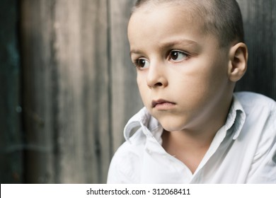 sad boy portrait,Old wooden background in behind