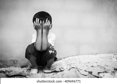 Sad boy sitting alone concept for bullying, depression stress or frustration,vintage tone