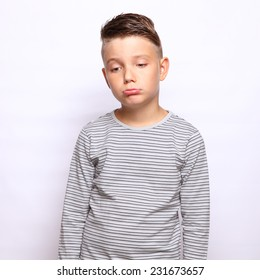 sad boy standing over white background