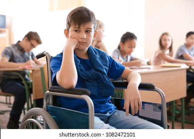 Sad boy in wheelchair at school