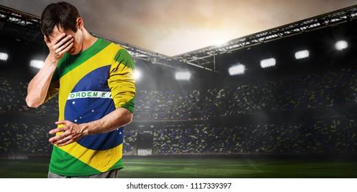 Sad Brazil national team soccer or football player on stadium