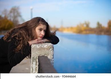 sad brunette girl outdoor