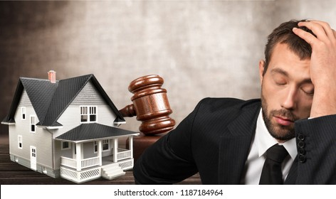 Sad businessman with Wooden judge gavel and