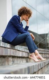 Sad businesswoman sitting in the office premises