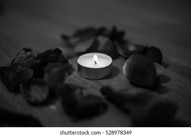 sad candle around roses petails