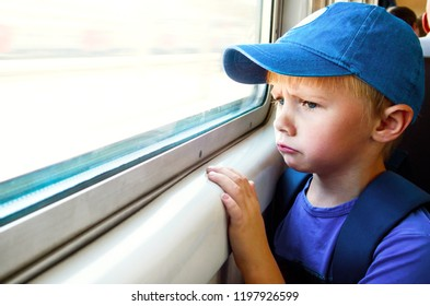 Sad Child Boy sit in the Train by the Window