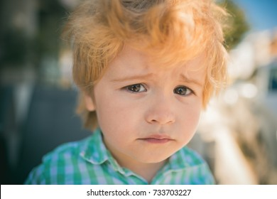 Sad child face, emotions and experiences. Children's frustration, frustrated boy 3 years old. Sad eyes of kid, sadness and pain, child wants to cry. Inner world loneliness. Upset boy looks at camera