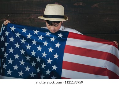 sad child with the flag of the United States,4th of July, Independence day