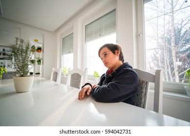 Sad child at home