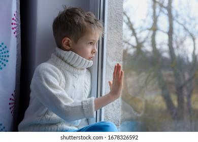 Sad child in home quarantine during a coronavirus epidemic.