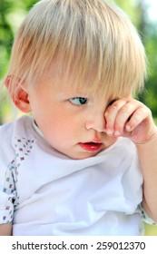 Sad Child Portrait at the Summer Park