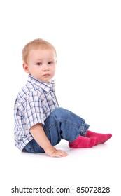 sad child sitting on floor crying over white background