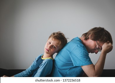 sad child with stressed father, family problems, sorrow