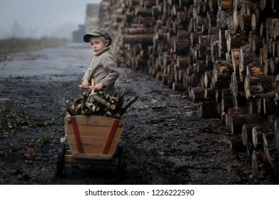 A sad child,  worker, work hard in a sawmill, social injustice, difficulties to overcome. Beautiful portrait of a boy, deep, emotional.