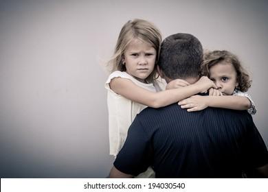 sad children hugging his dad
