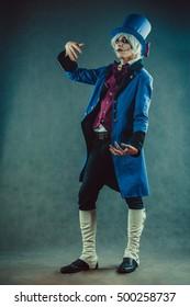 Sad circus actor in blue tuxedo.