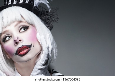 dc1b865b3 Sad clown make-up with uncombed white hair.Pensive woman in Halloween clown  costume