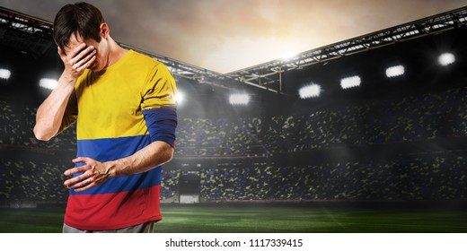 Sad Colombia national team soccer or football player on stadium