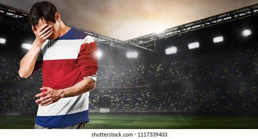 Sad Costa Rica national team soccer or football player on stadium