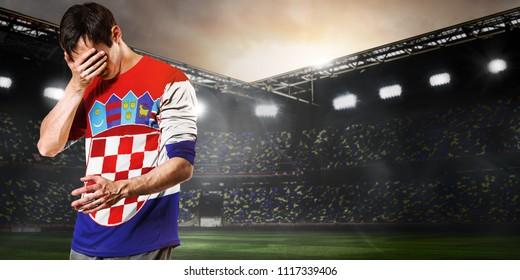 Sad Croatia national team soccer or football player on stadium