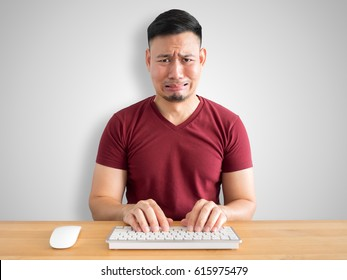 Sad and crying face of Asian man who failed his work.