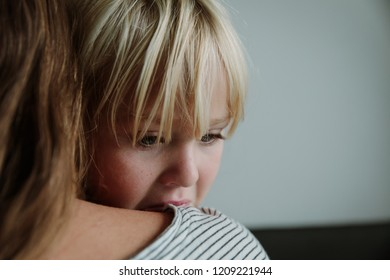sad crying little girl hugging mother, parenting