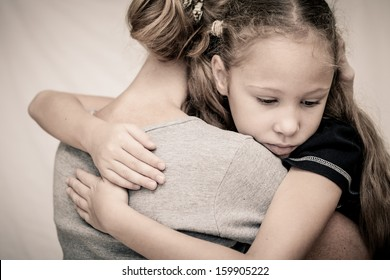 sad daughter hugging his mother