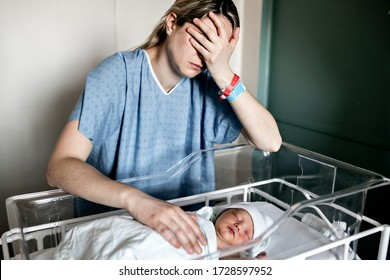 A Sad and depress Mother with her newborn baby at the hospital a day after a natural birth labor