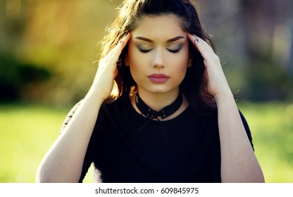 Sad Depressed Girl With Migraine. Outdoor Portrait. Stress and Depression Concept