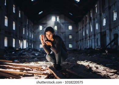 Sad depressed person in abandoned destroyed building crying.Emotional portrait.Mentally ill woman with bipolar disorder and psychosis.Schizophrenia.Madness, crazy person.Bizzare