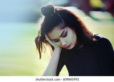 Sad Depressed Teen Girl Outdoor. Pensive Girl.