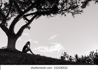 Sad and depressed woman deep in thought outdoors